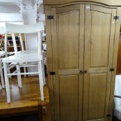 A Corona pine arch-top 2-door wardrobe, W100cm, H190cm, D55cm