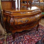 A Continental design stained wood bombe commode of serpentine form, with 2 short and 2 long drawers,