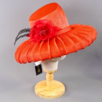 PETER BETTLEY LONDON - Coral red occasion hat, with flower and black feather detail, angled crown,