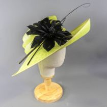 PETER BETTLEY LONDON - Lime green occasion hat, with black feather flower and twirl and stick