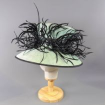 PETER BETTLEY LONDON - Mint green occasion hat, with black feather detail and trim, internal