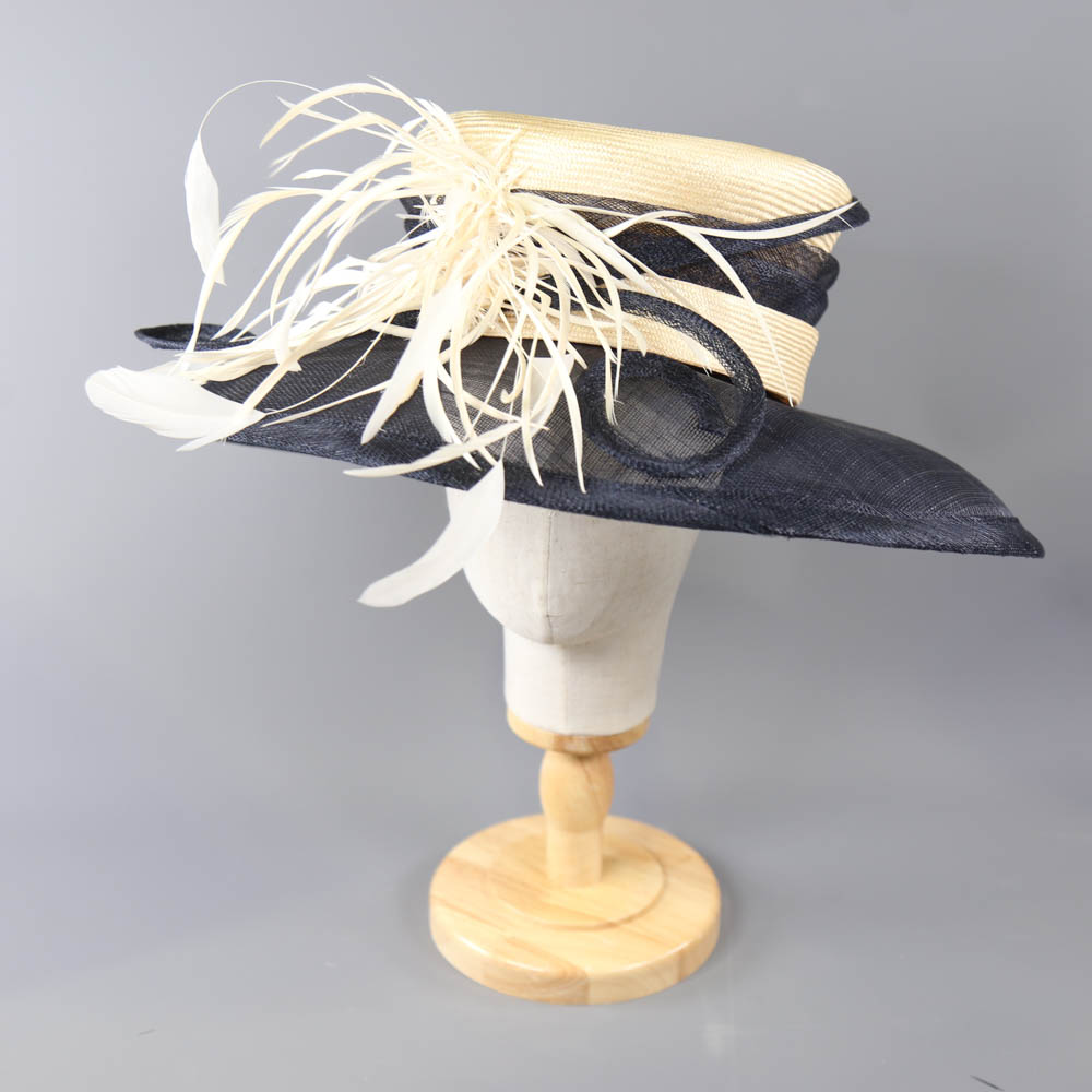 A HAT STUDIO DESIGN - Navy blue and straw occasion hat, with feather and twirl detail, internal