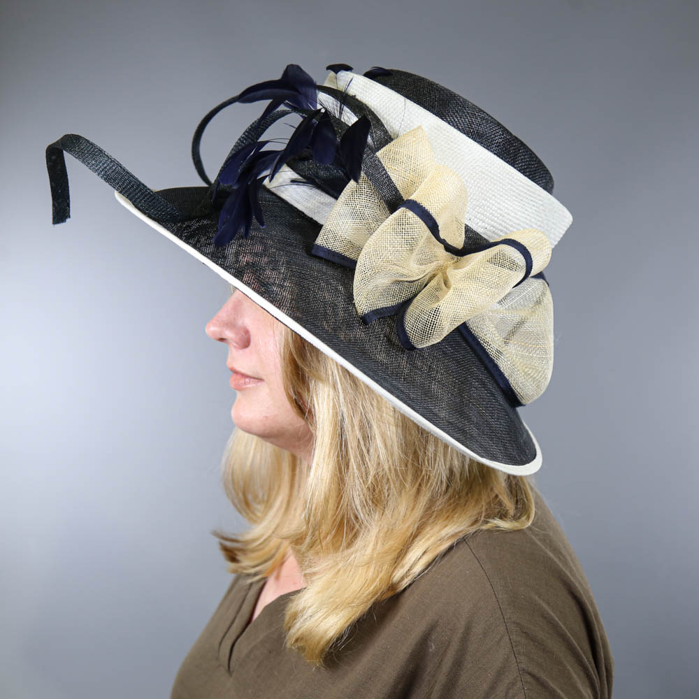 PETER BETTLEY LONDON - Navy blue and cream large brim occasion hat, with bow and feather details, - Image 7 of 7