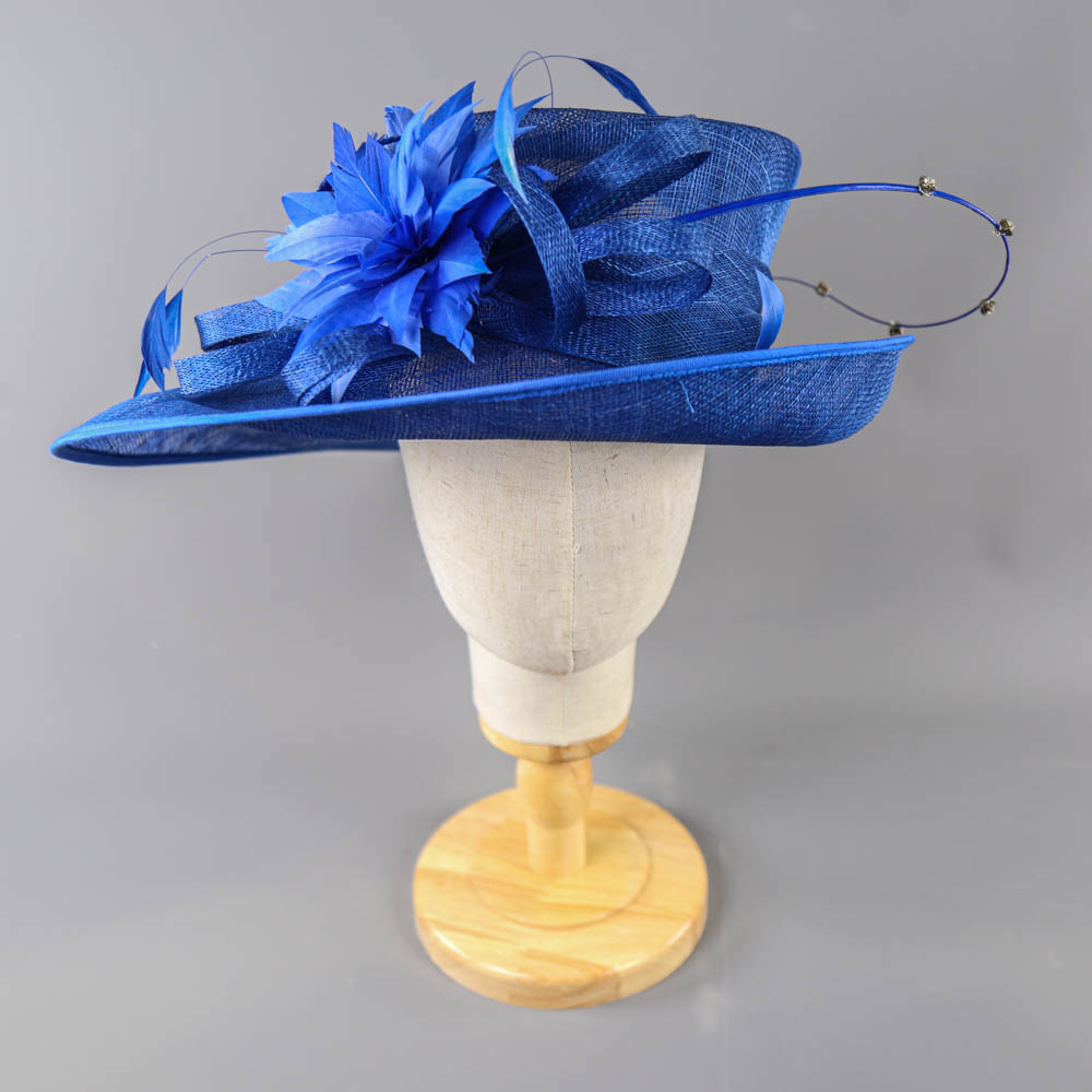 PETER BETTLEY LONDON - Royal blue occasion hat, with feather flower and diamanté twirl detail,