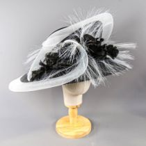 PETER BETTLEY LONDON - Black and white occasion hat, with flower and frayed mesh detail, internal