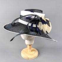 PETER BETTLEY LONDON - Navy blue and cream large brim occasion hat, with bow and feather details,