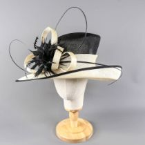 Black and ivory occasion hat, with feather and twirl detail, internal circumference 55cm, brim width