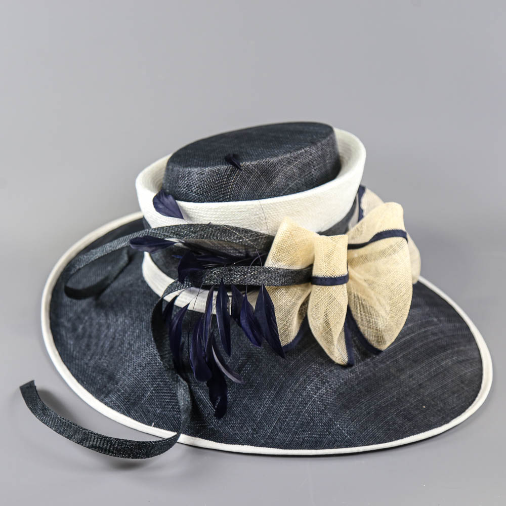 PETER BETTLEY LONDON - Navy blue and cream large brim occasion hat, with bow and feather details, - Image 6 of 7
