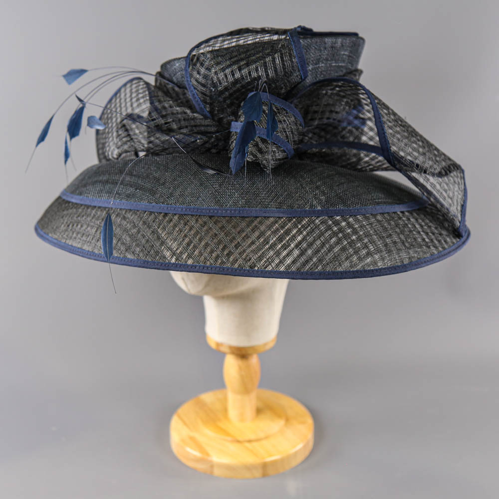 PETER BETTLEY LONDON - Black and navy blue occasion hat, with feather and bow detail, internal