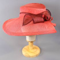 PETER BETTLEY LONDON - Coral pink and burgundy/brown occasion hat, with twirl detail, internal