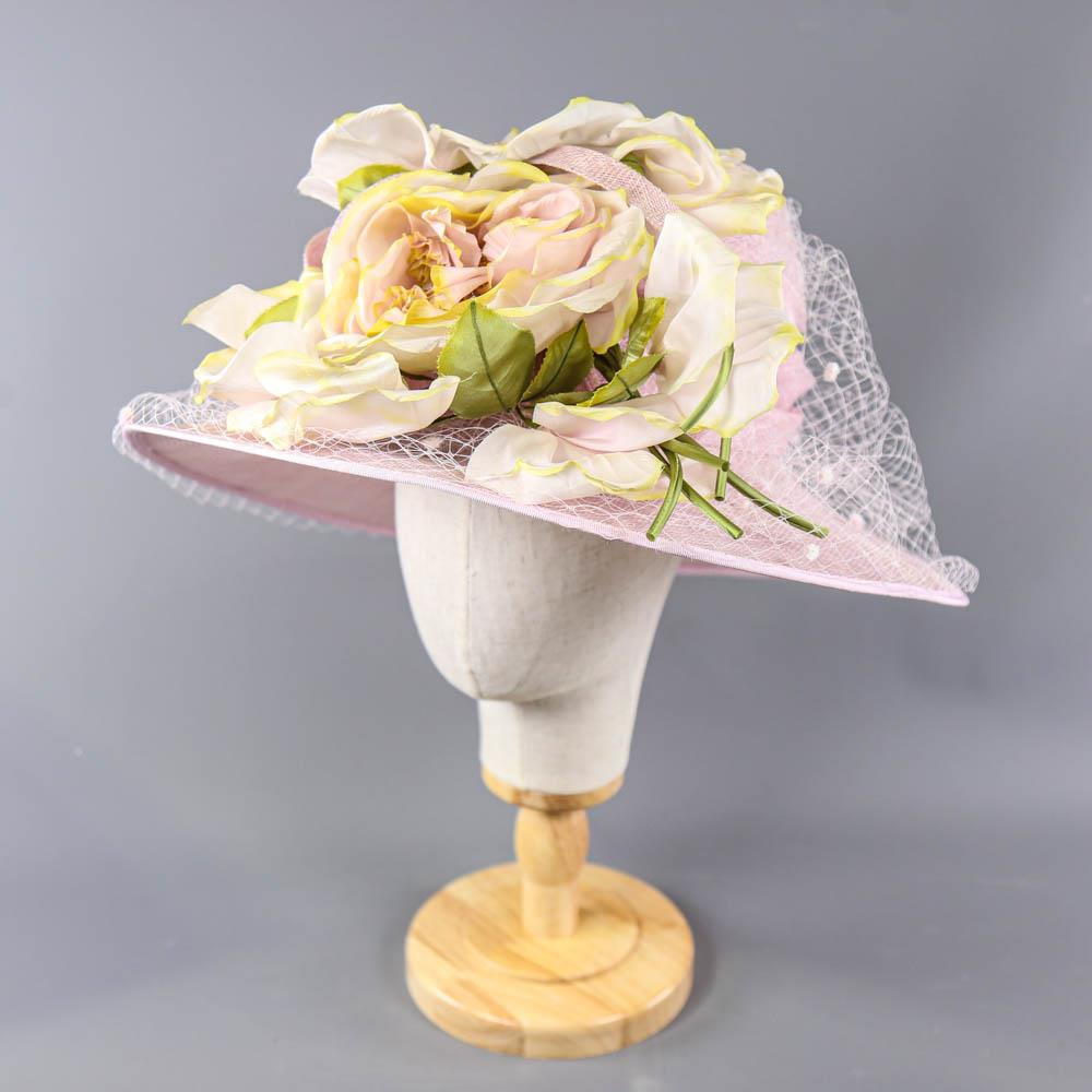 NIGEL RAYMENT - Soft lilac occasion hat, with flower and twirl and net and hat pin detail,