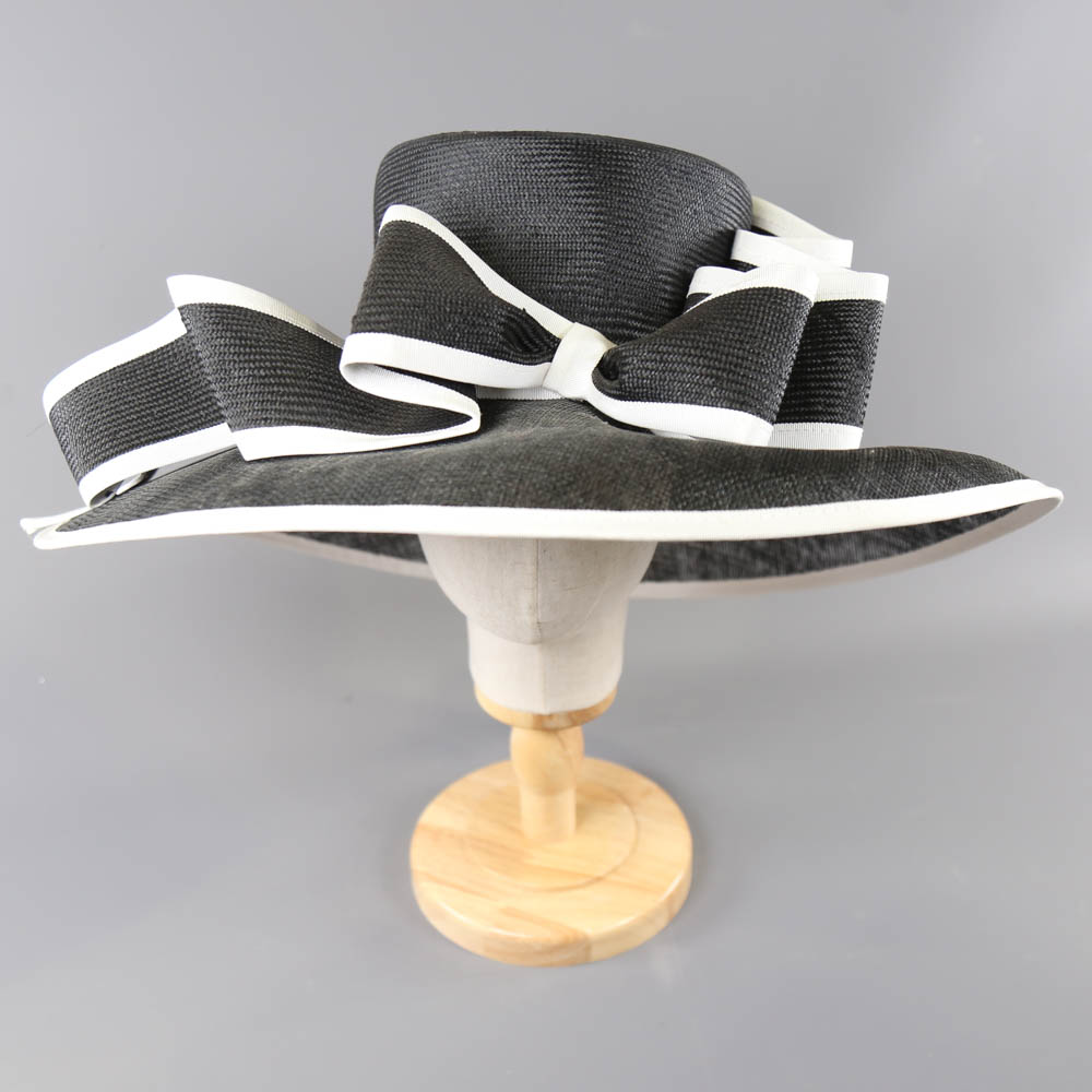 A HEADWAYS DESIGN FOR FRANK USHER - Monochrome black and white occasion hat, with bow detail and