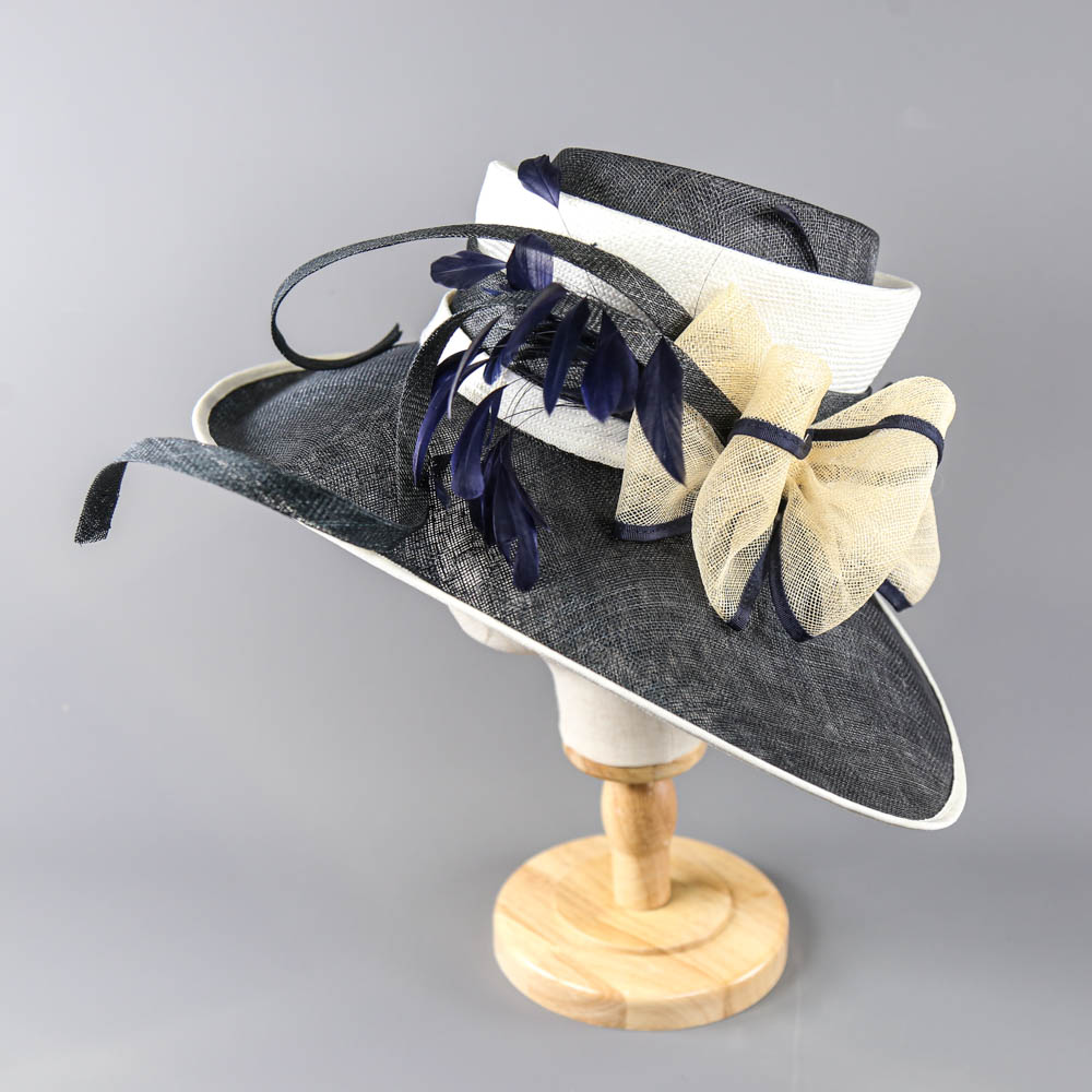PETER BETTLEY LONDON - Navy blue and cream large brim occasion hat, with bow and feather details, - Image 2 of 7