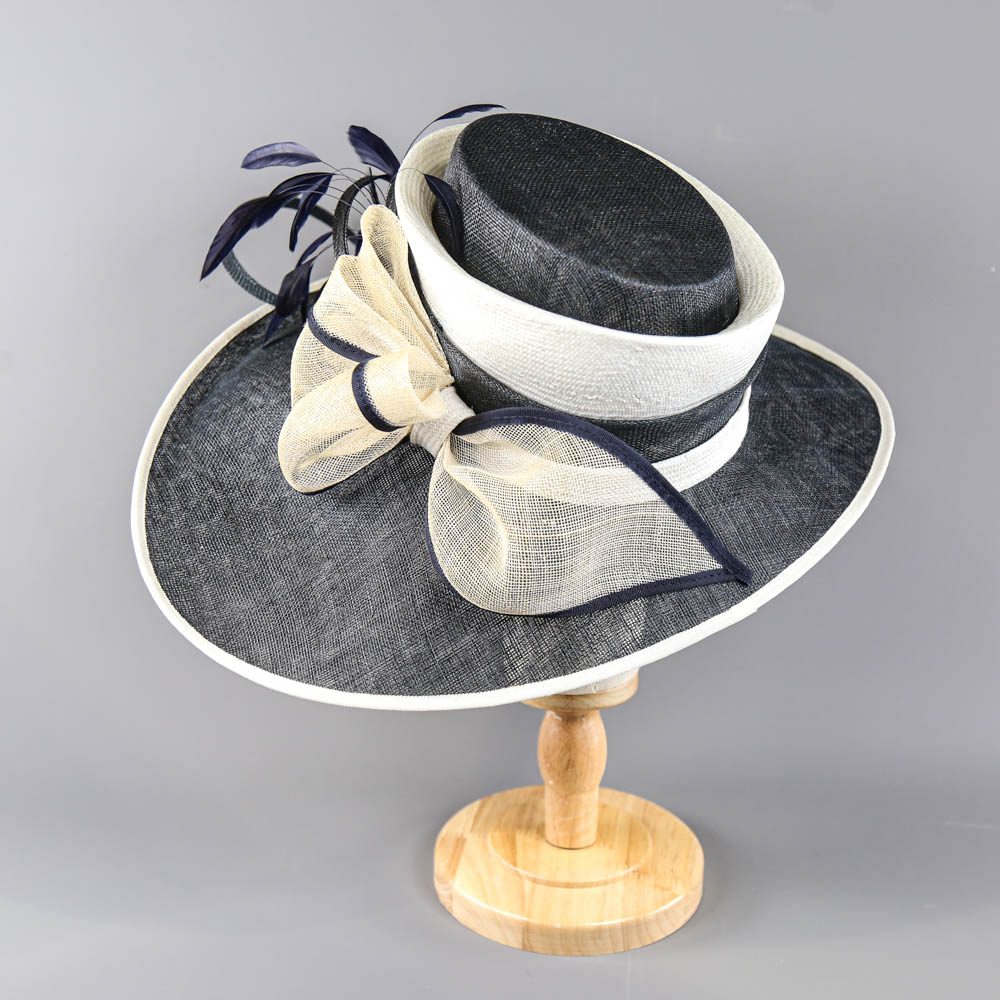PETER BETTLEY LONDON - Navy blue and cream large brim occasion hat, with bow and feather details, - Image 3 of 7