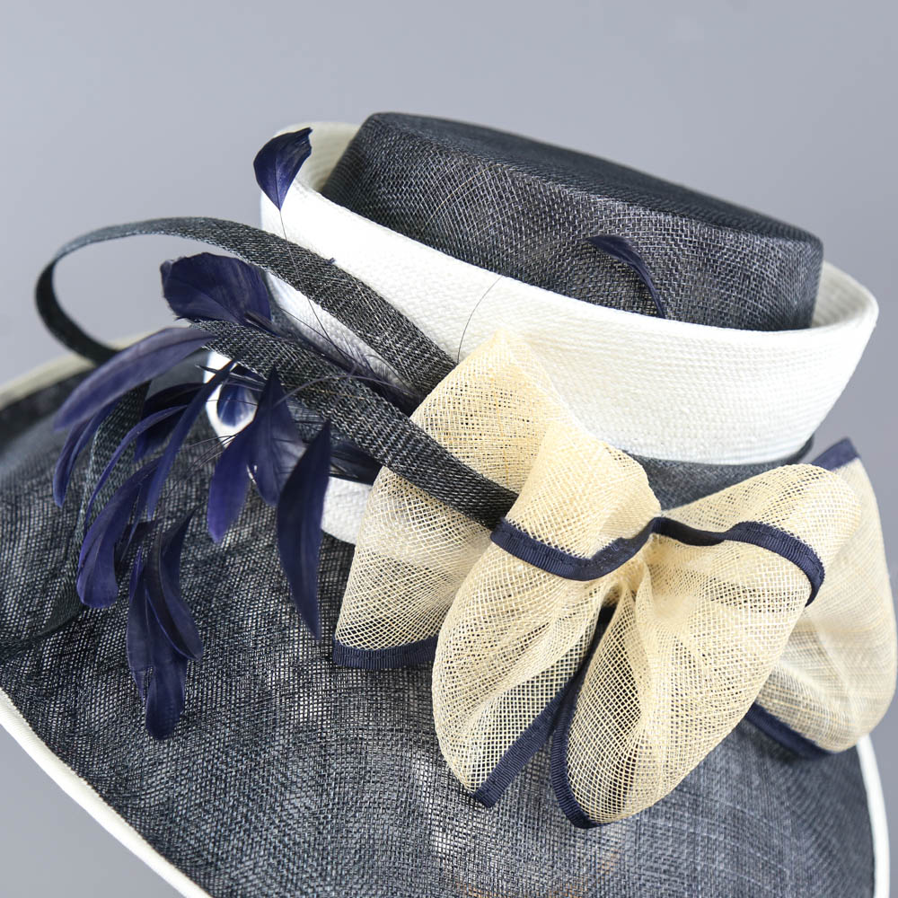 PETER BETTLEY LONDON - Navy blue and cream large brim occasion hat, with bow and feather details, - Image 4 of 7