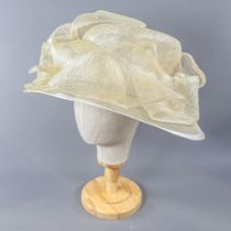 A HAT STUDIO DESIGN - Champagne and silver thread occasion hat, with frill detail, internal