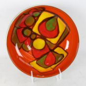 A Poole Pottery orange and green ground fruit bowl, model no. 89, diameter 23cm