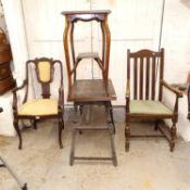 An Edwardian mahogany open-arm chair, an oak fold over card table, an elbow chair etc (4)