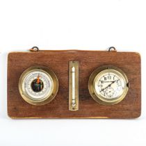 A wall-hanging combination aircraft clock/barometer/thermometer mounted on wooden plaque, clock dial
