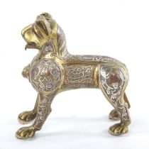 An Islamic bronze standing lion, possibly a lamp base, with inlaid silver and copper decoration