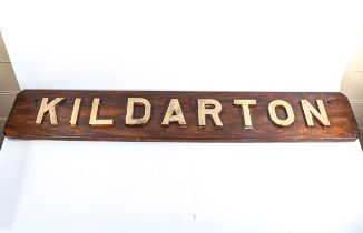 HMS Kildarton, bronze letter name plaque mounted on hardwood, overall dimensions 137cm x 24cm,