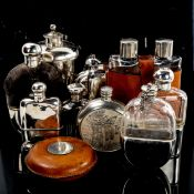 A collection of hip flasks and spirit flasks, including some silver