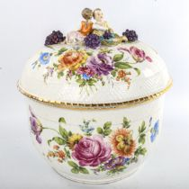 19th century Meissen porcelain punch bowl and cover, surmounted by a pair of children and grapes and