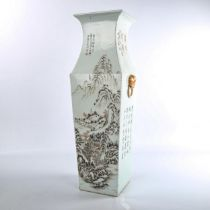 A Chinese white glaze porcelain square-section vase, with lion ring handles, hand painted mountain