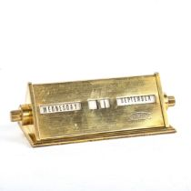 A Siemens polished brass-cased perpetual desk calendar of triangular form, length 11cm Good