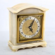 A Vintage polished onyx dome-top mantel clock, by Elliott of London, gilt dial with silvered chapter