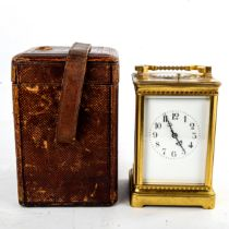A large French brass-cased repeater carriage clock, white enamel dial with Arabic numerals, blued