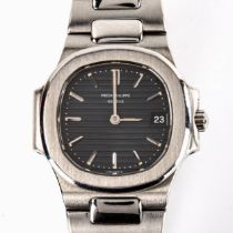 PATEK PHILIPPE - a lady's stainless steel Nautilus quartz bracelet watch, ref. 4700/1, circa