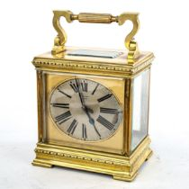 A large French brass-cased carriage clock, by L Vincent of Avignon, oval silvered dial with Roman