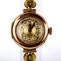 A lady's Vintage 9ct gold cased mechanical wristwatch, gilt dial with Arabic numerals and blued