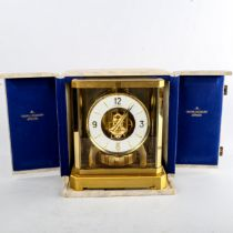 JAEGER LECOULTRE - a Vintage brass-cased Atmos clock, white chapter ring with gilt quarterly