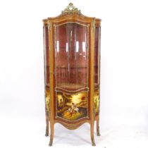 A Continental walnut design? vitrine cabinet of serpentine form, single-glazed door, with shaped