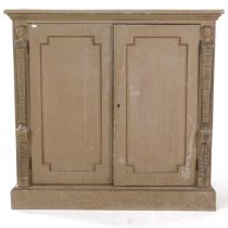 A painted 2-door cupboard, with adjustable shelves and figural carved pilasters, W113cm, H107cm,