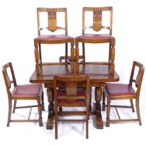 A 1930s oak draw leaf dining table, together with a set of 6 matching dining chairs with carved