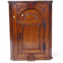 An Antique pine hanging corner cupboard, W71cm, H95cm