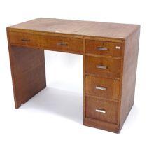 A 1930s Heals oak desk, W99cm, H76cm, D53cm
