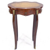 A Continental design walnut side table of shaped form, with single frieze drawer, cabriole legs, and