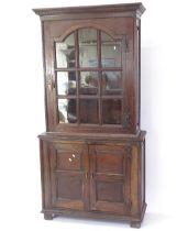 An Antique oak 2-section bookcase, with cupboards under, W100cm, H200cm, D42cm