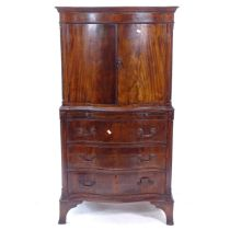 A 1920s mahogany cabinet on chest, of serpentine form, with bracket feet, W68cm, H128cm, D45cm
