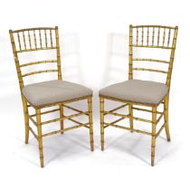 A pair of gilt faux bamboo chairs
