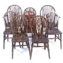 A set of 8 oak and elm-seated wheel-back dining chairs (6 and 2)