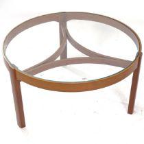 A mid-century circular glass-top teak coffee table, W82cm