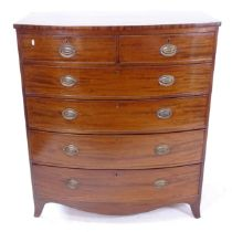 A Regency mahogany bow-front chest, with 2 short and 4 long drawers, on bracket feet, W105cm,