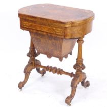 A Victorian burr-walnut combination sewing/game-top table, the foldout top revealing the games