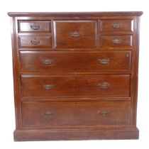 A large Edwardian mahogany chest, with central hat drawer, 4 short and 3 long drawers, W122cm,