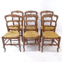 A set of 6 French oak ladder-back and rush-seated dining chairs